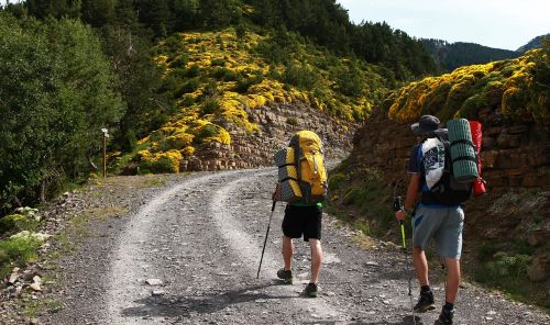 Hikers with heavy backpacks